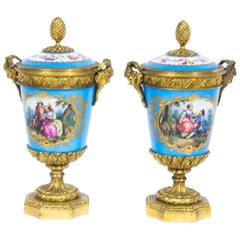 19th Century Pair of French Ormolu-Mounted Sèvres Lidded Urns Vases
