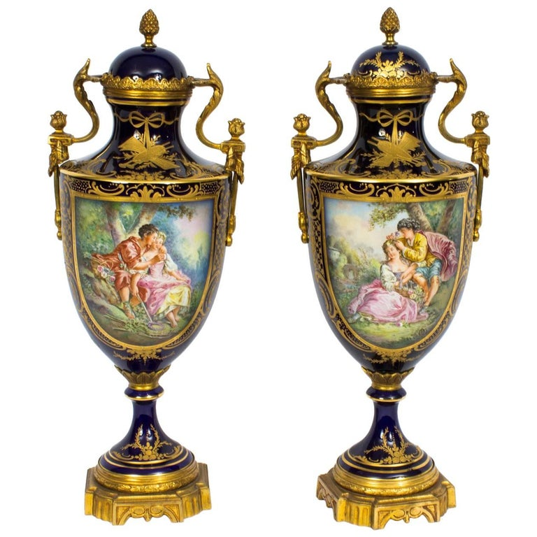 Early 20th Century Pair of Ormolu-Mounted Sevres Style Lidded Urns Vases