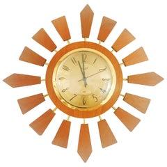 Anstey Wilson England Brass and Teak Sunburst Clock, circa 1950