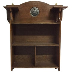 Shapland and Petter, Arts & Crafts Hanging Oak Bookcase with Silvered Plaque