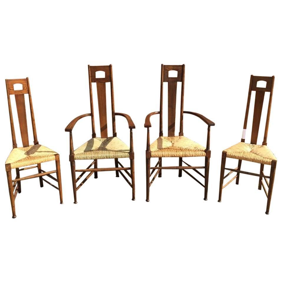 E G Punnet Attri, for William Birch Set of Four Glasgow School Oak & Rush Chairs