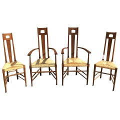 E G Punnet Attri, for William Birch Set of Four Glasgow School Oak & Rush Chairs