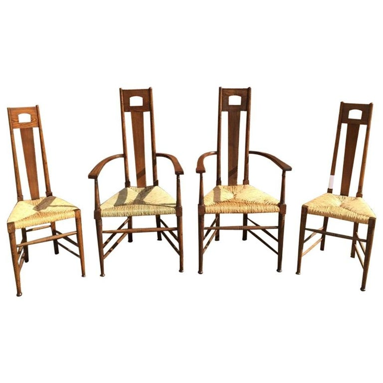 Set of four glasgow school oak dining chairs attributed to