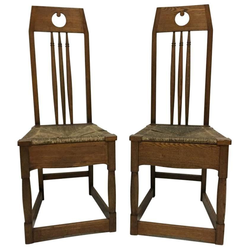 Shapland and Petter, a Pair of Ash Side Chairs in the Style of M H Baillie Scott