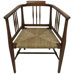 E A Taylor, Wylie and Lochhead or Shapland & Petter. A Fine Rush Seated Armchair
