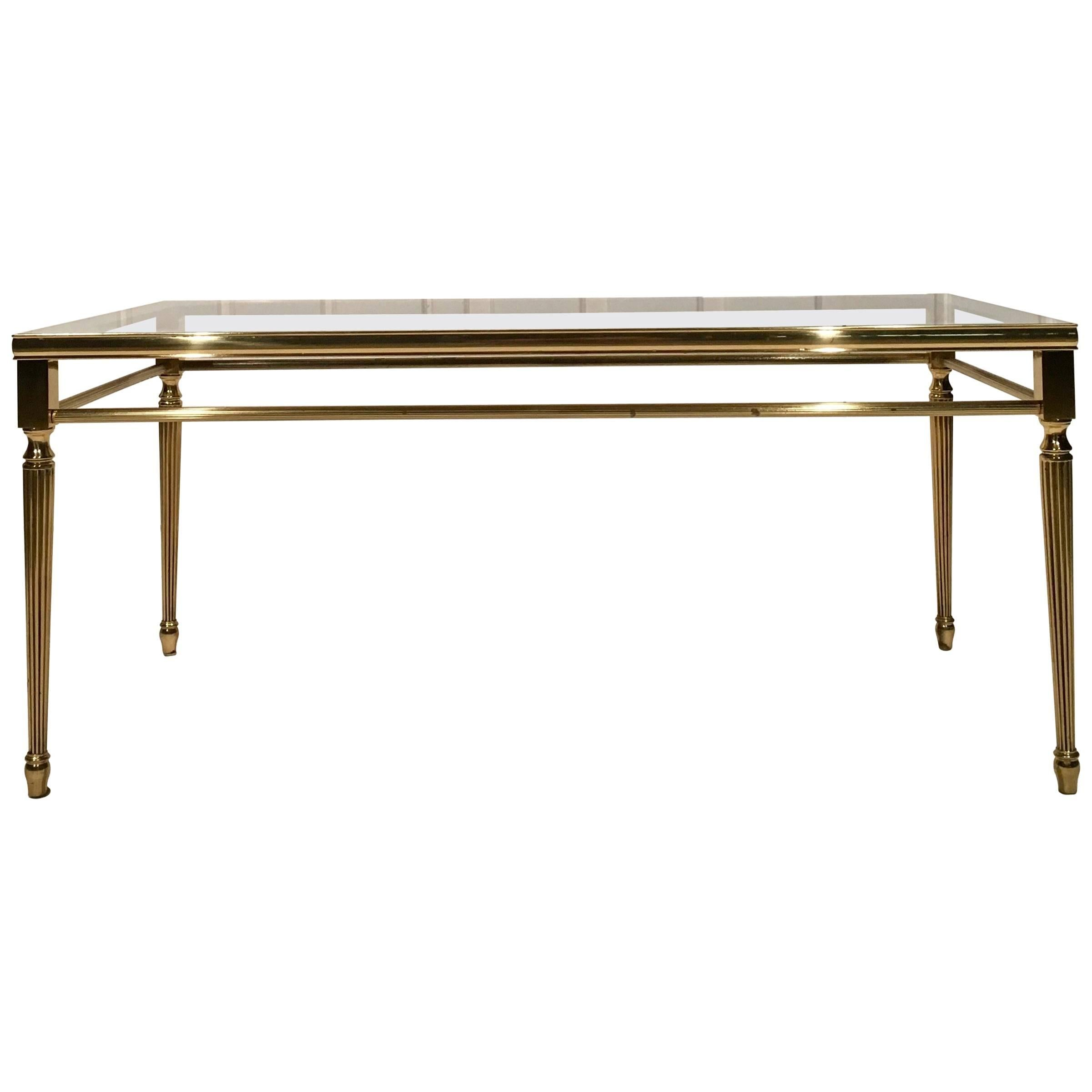 antique coffee table in brass with glass top
