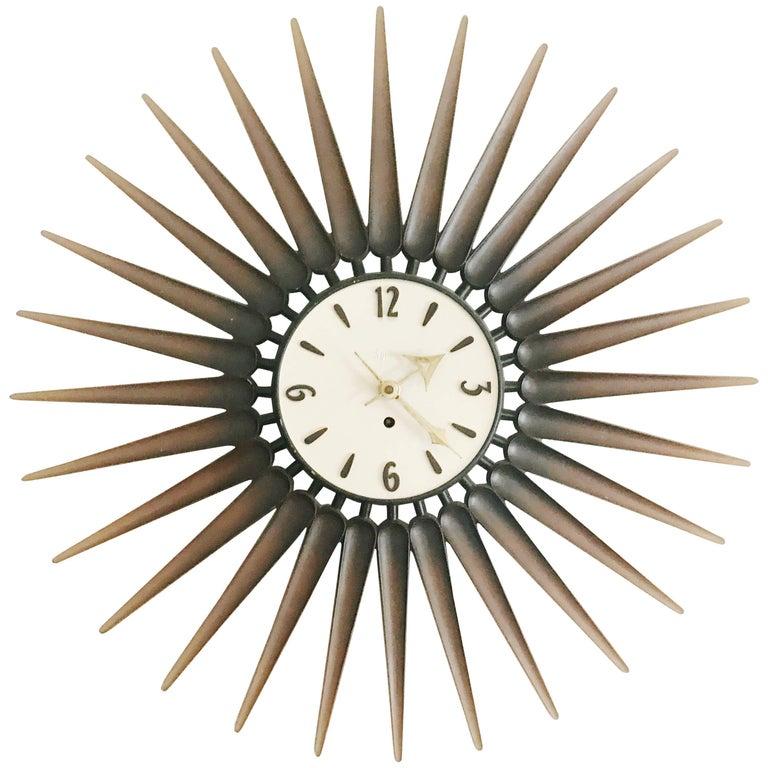 Danish Style Syroco Wood Sunburst Clock, circa 1950