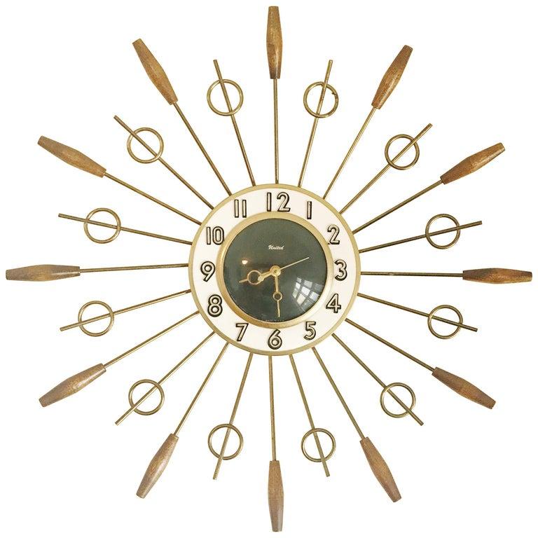 United Brass Spindles Sunburst Clock, circa 1950 For Sale
