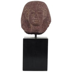 Egyptian Carved Red Granite Head of a Pharaoh Ptolemaic Period Form