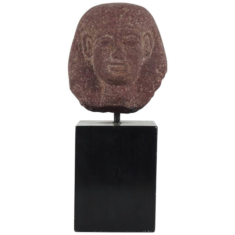 Egyptian Carved Red Granite Head of a Pharaoh Ptolemaic Period Form For Sale