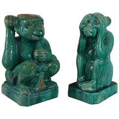 Two Companion Glazed Terra Cotta Monkeys