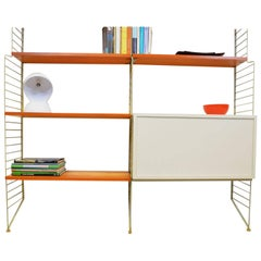 String Wall System with Cabinet by Nisse Strinning