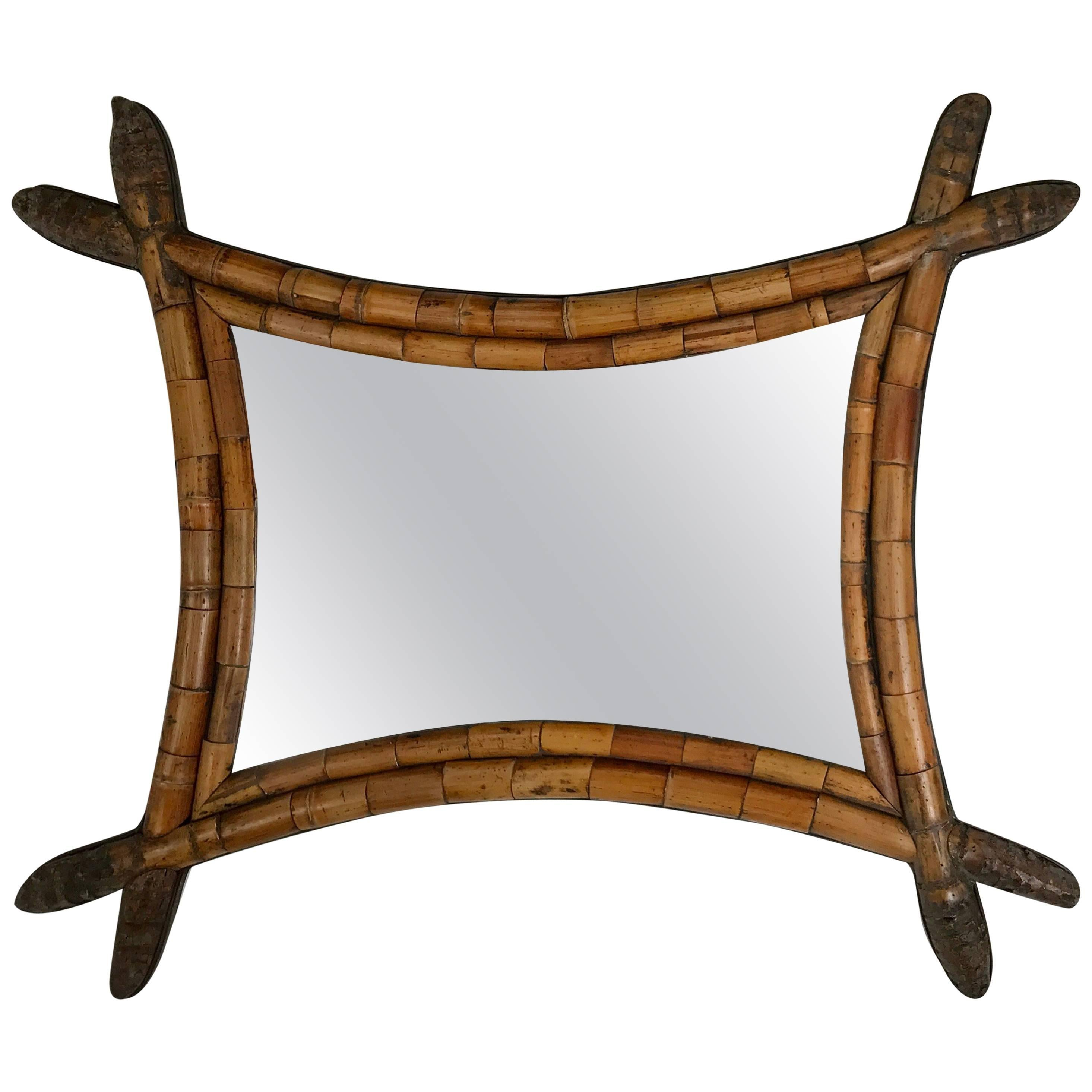 early and unusual asian style bamboo mirror