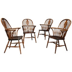 Set of Four Early 20th Century Ash and Elm Wheelback Windsor Armchairs