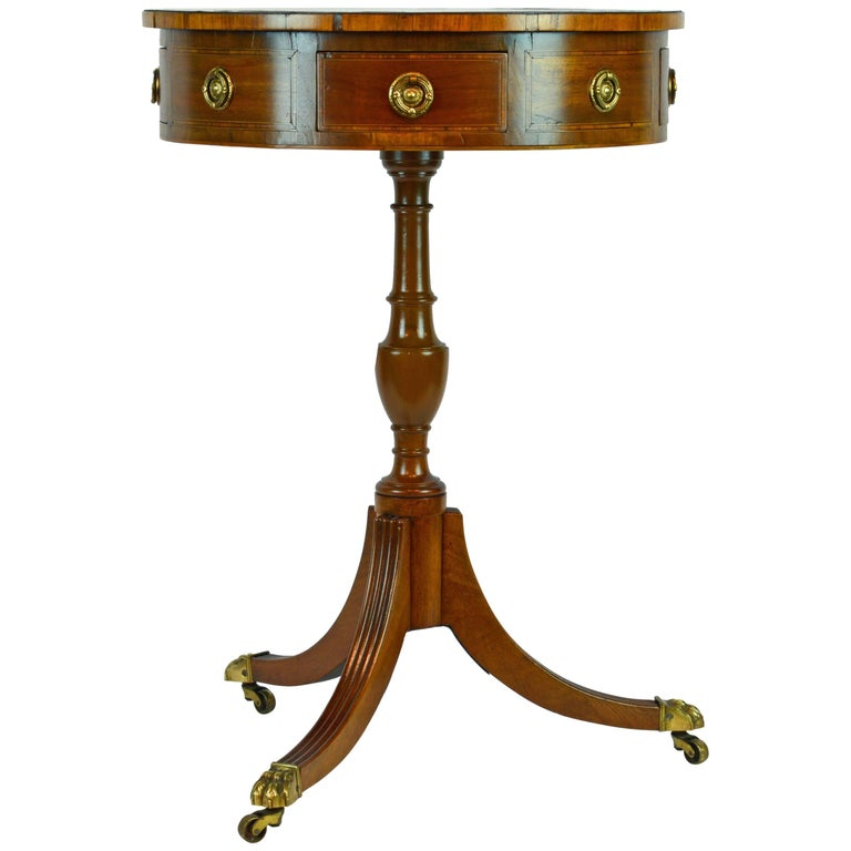 Petite English Regency Style Four-Drawer Leather Top Drum Occasional Table For Sale