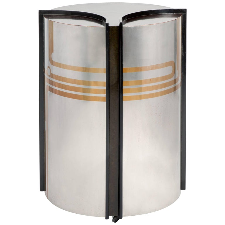 Pierre Cardin is an Italian-born French fashion designer known for avant-garde and Space Age designs, as demonstrated by this bar cabinet. 