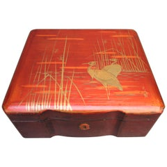 Japanese Burnt Orange Lacquered Box with Gold Painted Cranes