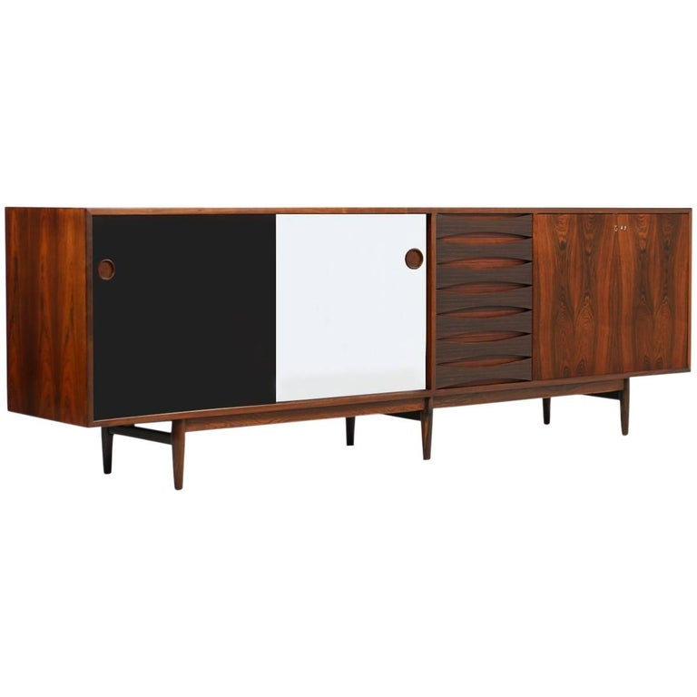 A beauty in very good condition. The rare rosewood sideboard was designed by Arne Vodder, produced by Sibast Furniture, Denmark in the 1960s. Model 29A with seven drawers and another door, very clean. Fantastic design, freestanding model, also the