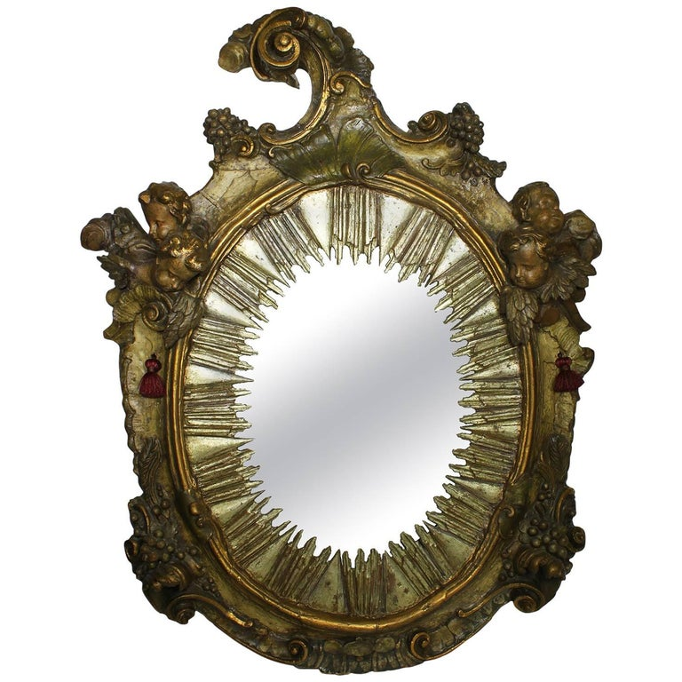 Italian Baroque 18th Century Parcel-Gilt Silver Carved Wood Mirror with Cherubs
