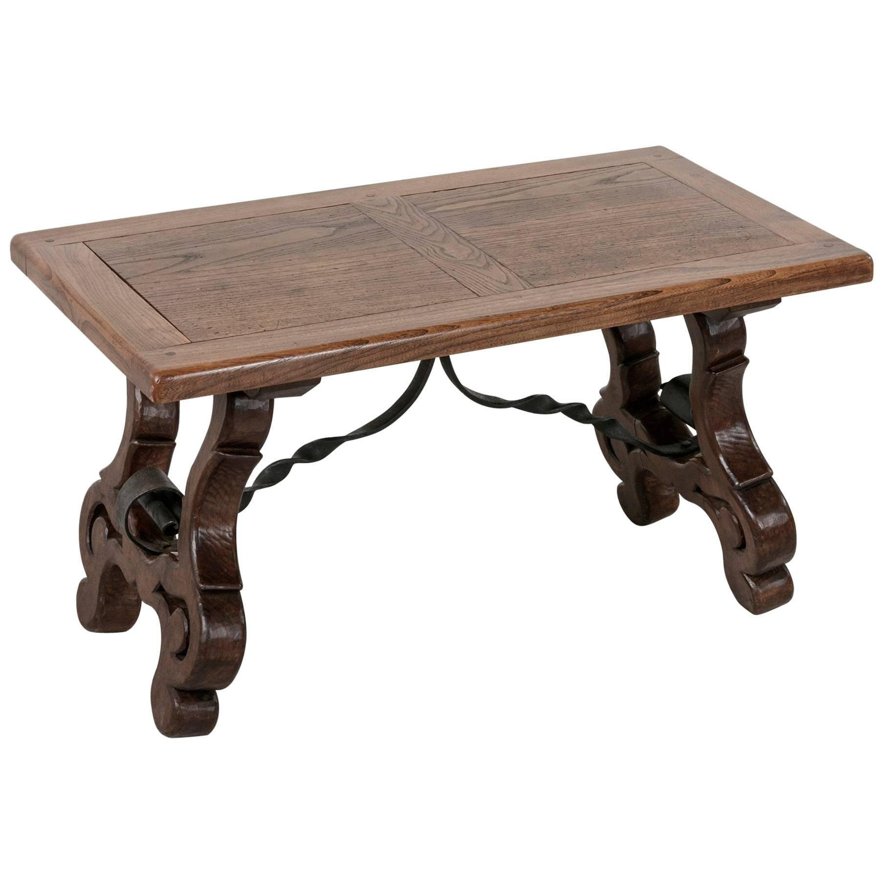Early 20th Century Spanish Style Oak Coffee Table Or Bench With Iron  Stretcher For Sale