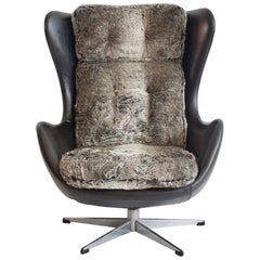 Danish Swivel Armchair Upholstered with Black Leather and Faux Fur