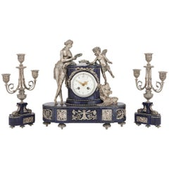 Antique French Lapis Lazuli and Silvered Bronze Three-Piece Clock Set