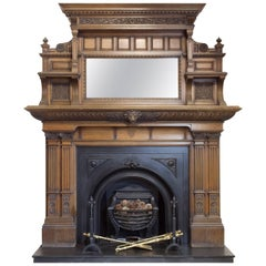 19th Century Victorian Carved Oak Fire Surround with Arched Cast Iron Insert