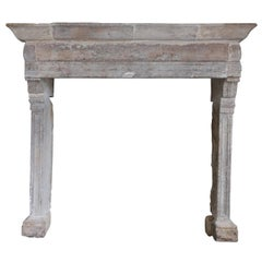 Rare and sober antique french fireplace of the 18th century
