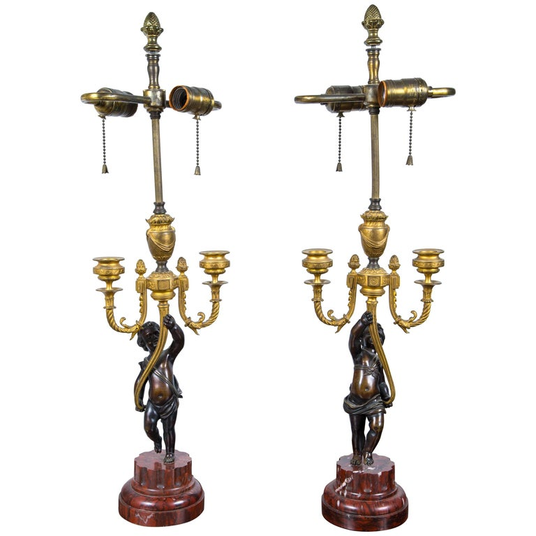 Pair of Antique Gilt and Patinated Bronze Putti Candelabra
