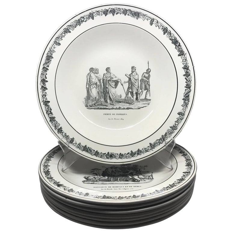 """Creil creamware plates. Set of eight decorative black and white Creil soup plates featuring Cupid, or """"L'Amour,"""" in four different scenes among other varying classical subjects; all with grapevine border. Impressed and underglaze markings for Creil,"""