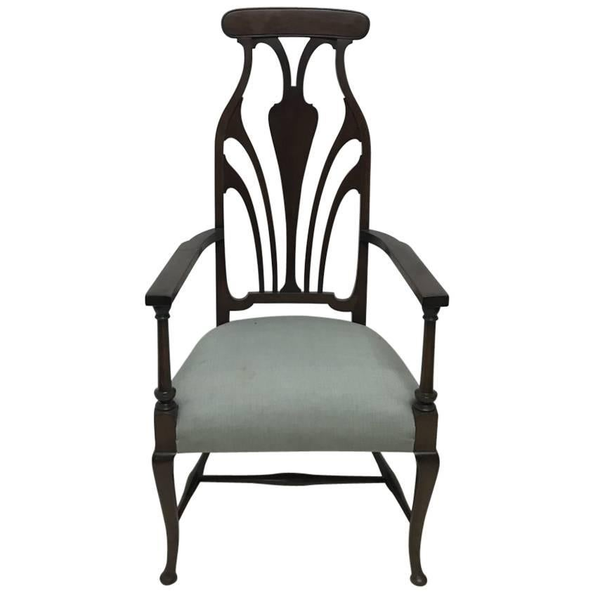Liberty & Co. An Arts & Crafts Mahogany Armchair with an Art Nouveau Style Back