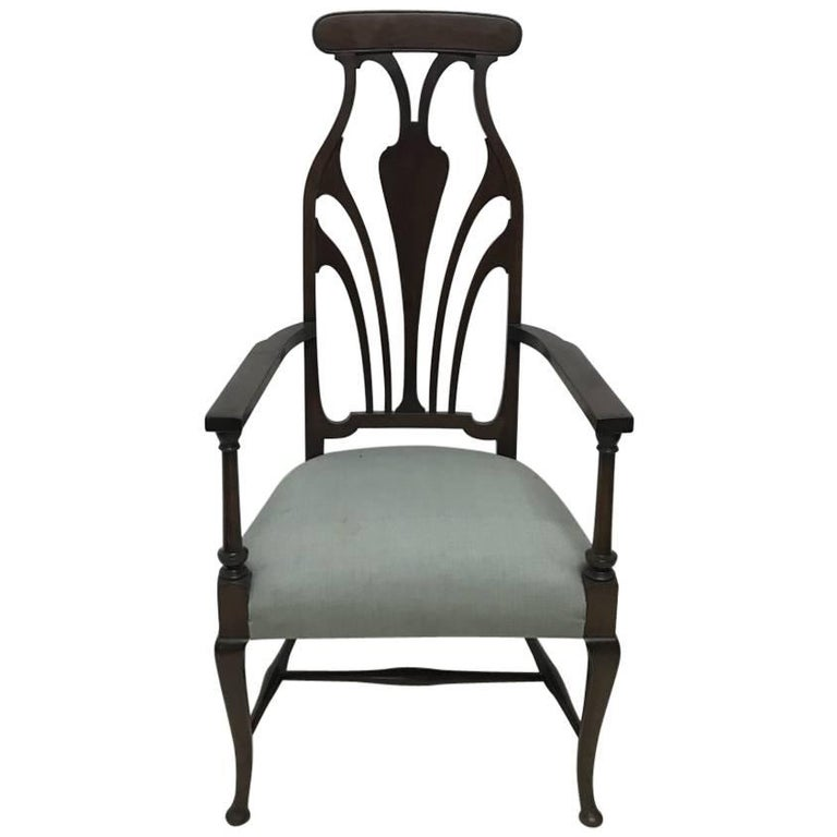 Liberty & Co. An Arts & Crafts Mahogany Armchair with an Art Nouveau Style Back  For Sale