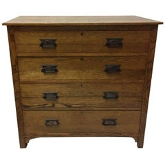 Harris Lebus Arts and Crafts Oak Chest of Drawers with Floral Detailed Handles