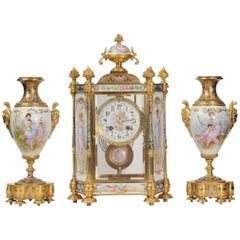 Sèvres Porcelain and Champlevé Enamel Clock Set