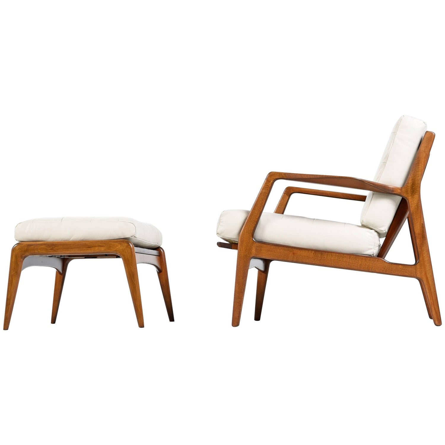 This sculptural pair of lounge chairs by ib kofod larsen is no longer - Ib Kofod Larsen Bone Ivory Leather Danish Chair And Ottoman