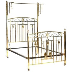 An Arts & Crafts Cast Brass Half Tester Double Bed with Stylised Floral Details
