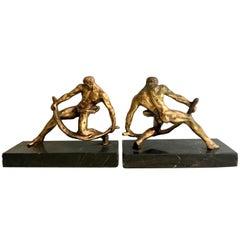 Pair of Gilt Sculptural Male Muscular Bookends