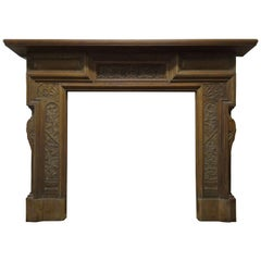 19th Century Victorian Stripped Walnut Fire Surround with Carved Sun God