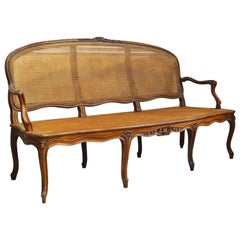 Late 18th Century Provincial Louis XV Style Carved and Caned Walnut Settee