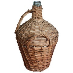 French Handwoven Basket with a Large Demijohn Glass Wine Bottle