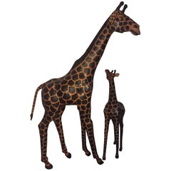 Pair of Life-Size Giraffes Each Made of Painted Leather