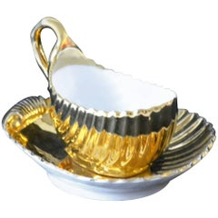 Meissen Porcelain Gold Shell-Shaped Gravy Boat and Saucer