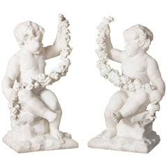 Pair of Neoclassical Style French Antique Carved White Marble Cherubs