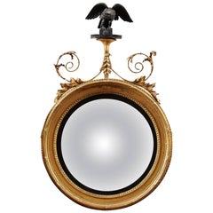 English Regency Giltwood Bullseye Convex Mirror with Eagle Crest, circa 1820