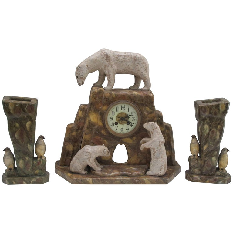 Wood polar bears on mantel clock with pair of vases with penguins, 1920s