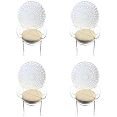 Four Hollywood Regency Wrought Iron Sunburst Garden Armchairs