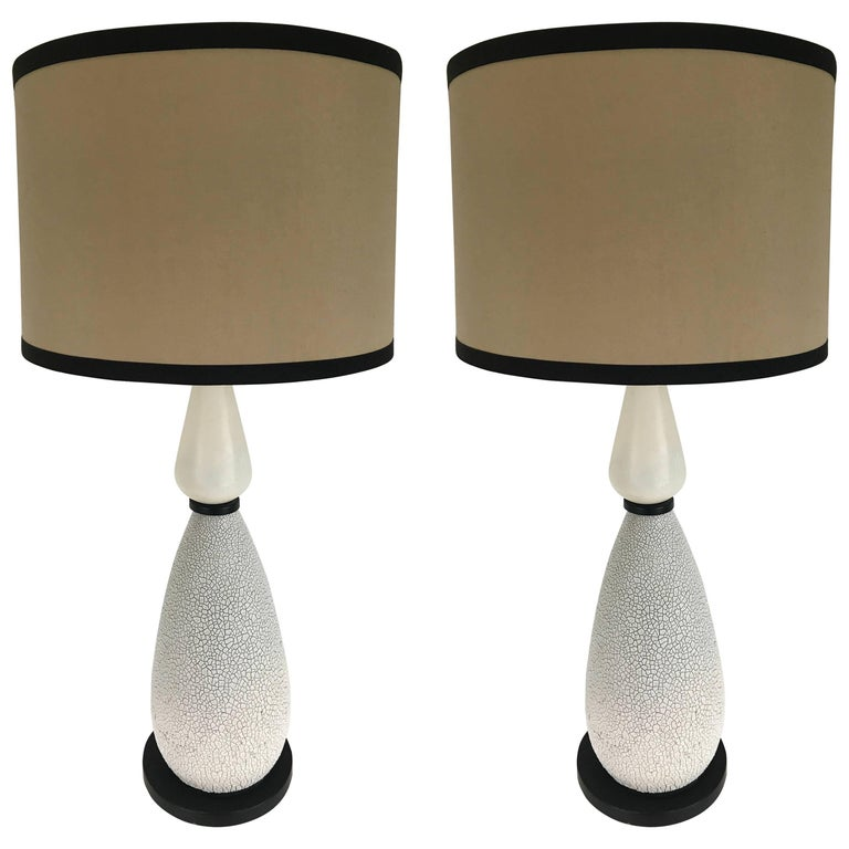 A pair of tall Mid-Century table lamps. Consisting of two gourd shaped spheres, one crackled and the other smooth. Shown with original tall shade and smaller drum shade. Both for display purposes only.