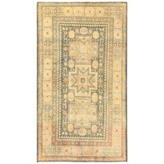 Antique Caucasian Rug with Tribal Motifs