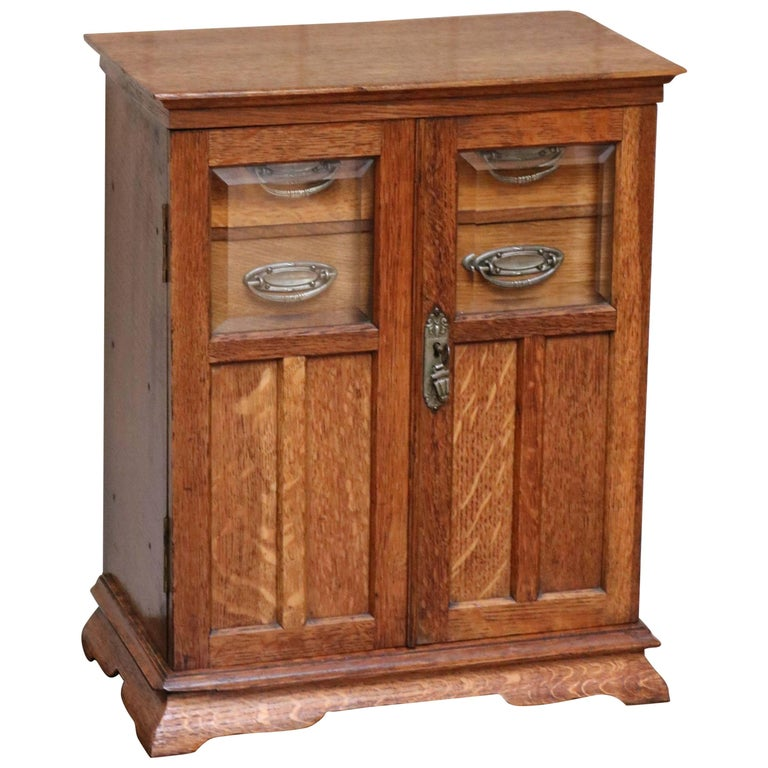 Arts and crafts oak smokers table cabinet at 1stdibs for Arts and crafts storage cabinet