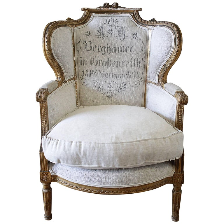 Antique French Louis XVI Style Wing Chair in Antique Grain Sack Upholstery  For Sale - Antique French Louis XVI Style Wing Chair In Antique Grain Sack